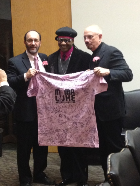 Councilman Anthony Brancatelli and CEO of the Rock and Roll Hall of Fame and Museum Terry Stewart with Kangol Kid and the Mama Luke autographed T-shirt